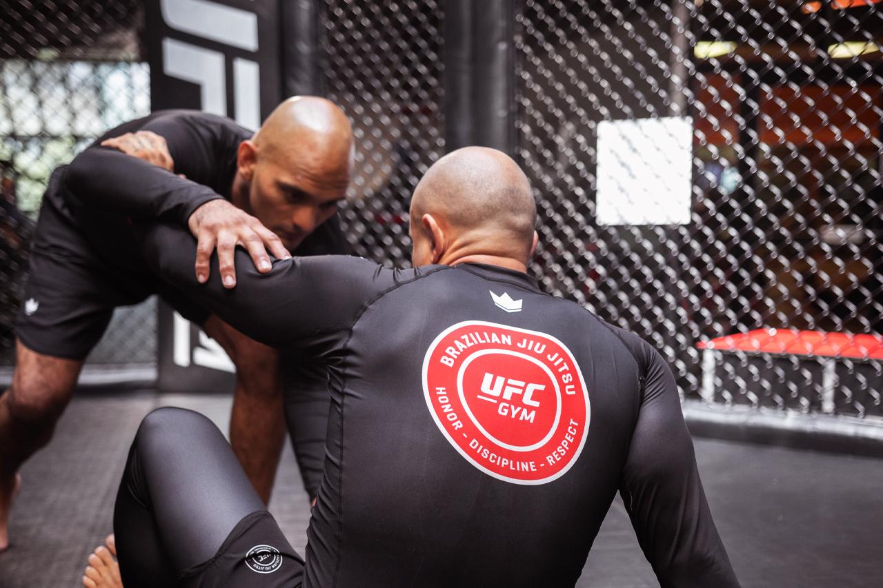 Two Members practice brazillian jiu-jitsu