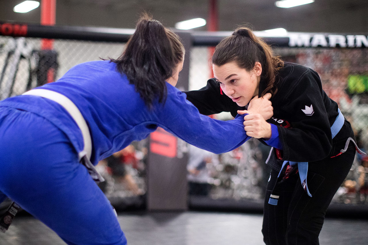 Two female members practice brazilian jiu-jitsu