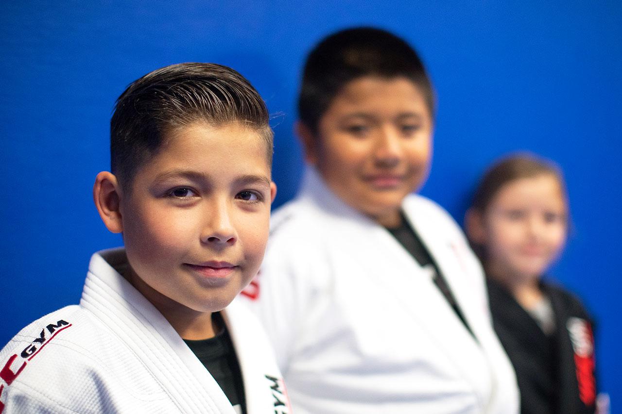 Three young members smiling at camera