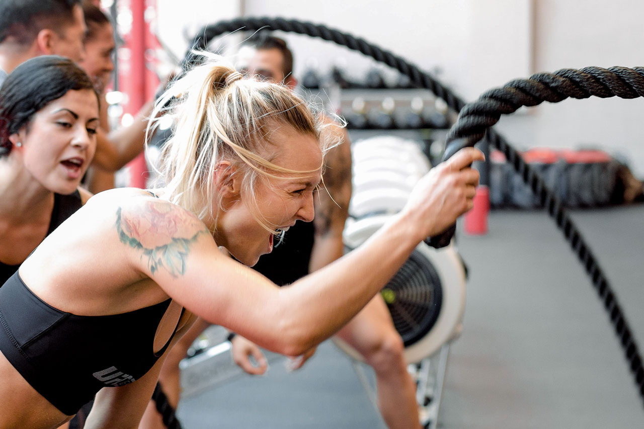 Woman workout out with battle ropes